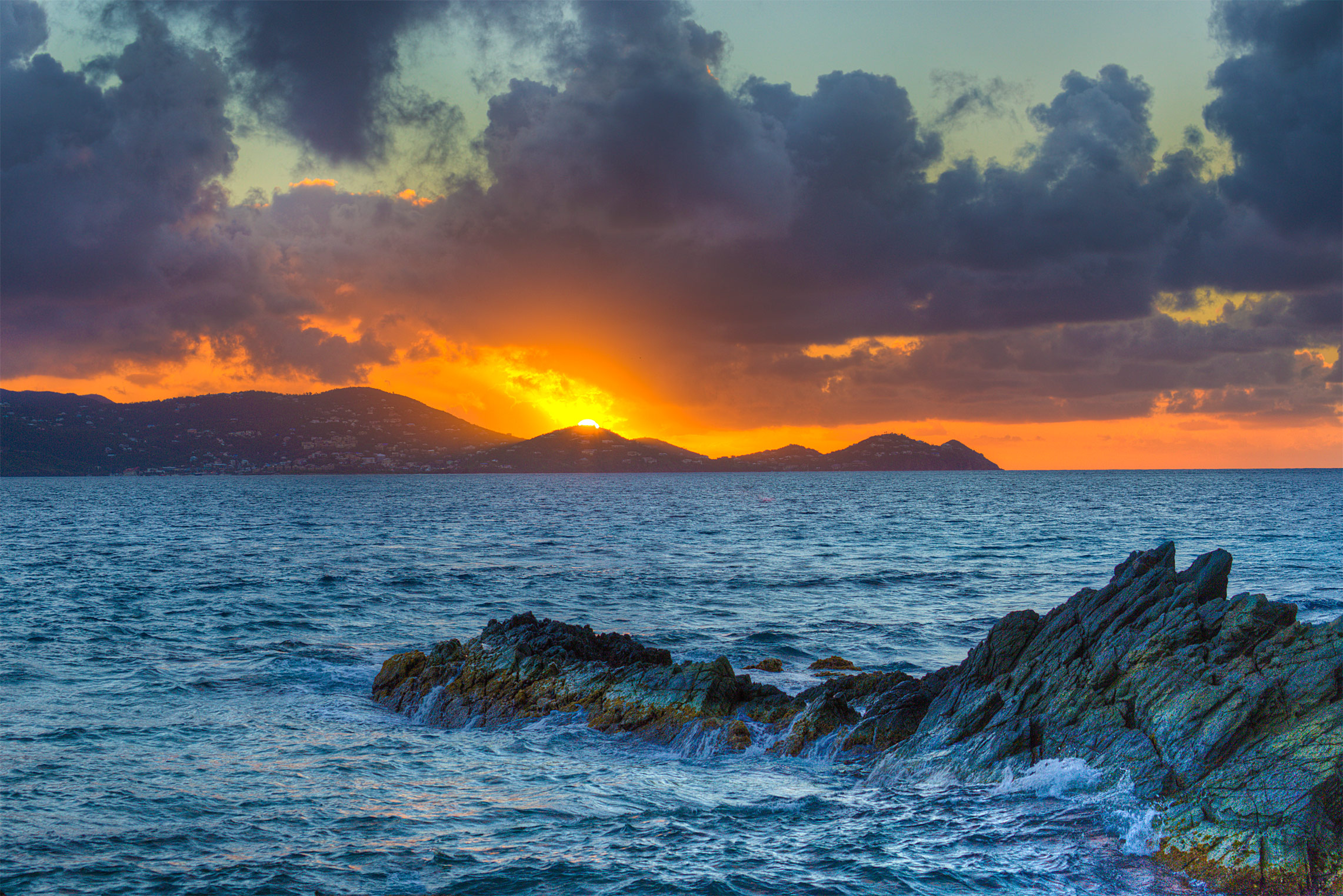 The sun sets over St. John