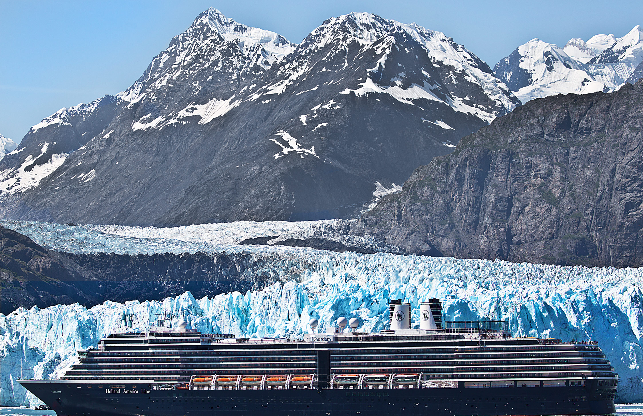 A Cruise Ship poses in front of the  Margerie Glacier
