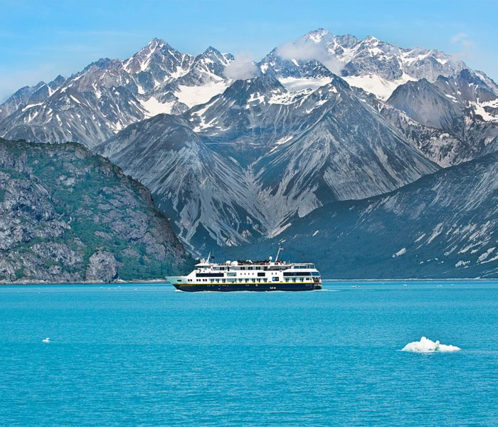 A ferry passes amidst the glaciers in Glacier Bay National Park